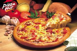 Pizza Hut slices 50% off pizza prices online